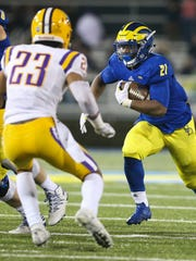Delaware running back Khory Spruill carries in the