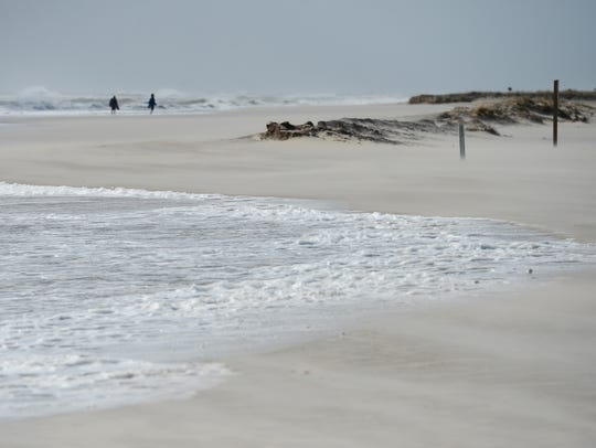 The surf covers a section of Assateague beach where