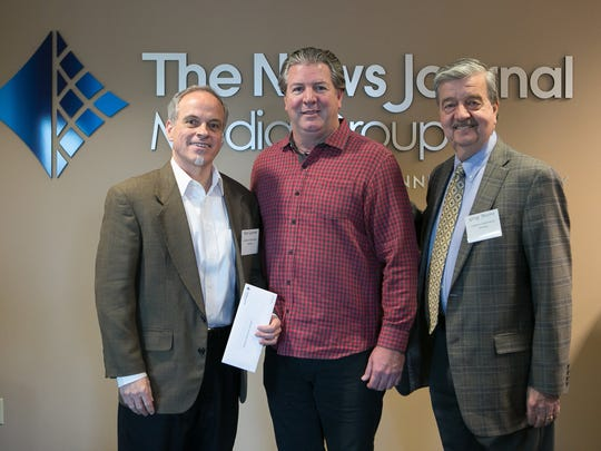 Rob Gurnee (left) and Greg Moore (right) with Lutheran Community Services receive a Gannett Foundation Grant from Thomas Donovan, President/Publisher and Northeast Regional President of Gannett East Group.