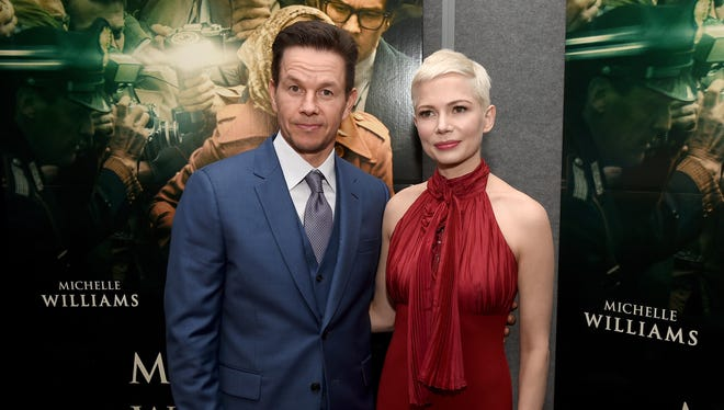 Sources tell USA TODAY Mark Wahlberg was paid $1.5 million for 'All the Money in the World' reshoots while Michelle Williams received less than $1,000.