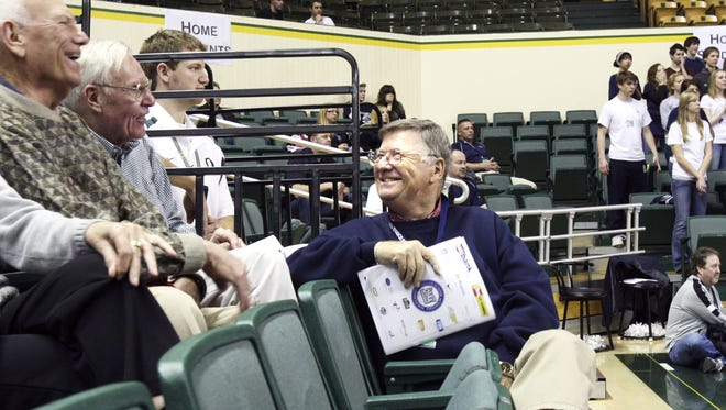 Ten years after a heart transplant, Lou Littlejohn is still going strong. A long-time basketball coach, he now helps out any way he can, including volunteering at the OSAA basketball tournament in Eugene, Saturday, March 14, 2009.