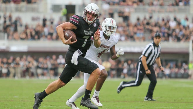 Mississippi State's Nick Fitzgerald (7) heads to the end zone for a touchdown.