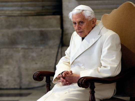 Pope Emeritus Benedict XVI attends a Mass prior to the opening of the Holy Door of St. Peter's Basilica, formally starting the Jubilee of Mercy, at the Vatican on Dec. 8, 2015.