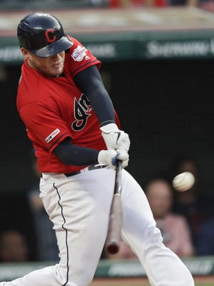 Cleveland Indians' Roberto Perez hits a solo home run during a 2019 home game against the Los Angeles Angels.