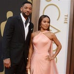 FILE - In this March 2, 2014, file photo, Will Smith, left, and Jada Pinkett Smith arrive at the Oscars at the Dolby Theatre in Los Angeles. Smith said Thursday, Jan. 21, 2016, he will not attend the Academy Awards next month, joining his wife, Jada Pinkett Smith, and others in protest against two straight years of all-white acting nominees.