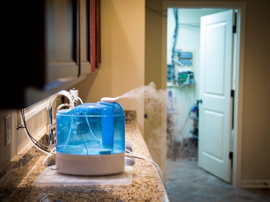Humidifiers are placed around the house to simulate