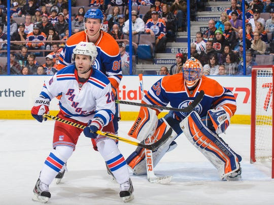 Martin Marincin, left, and Ben Scrivens of the Edmonton Oilers defend against the Rangers' Martin St. Louis.