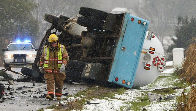 Emergency personnel respond to the scene of a fatal accident on state Route 8 in Union Township, Pa., on Oct. 24. A propane tanker truck collided with a car.