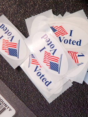 """I voted"" stickers on a ballot box in Loveland, Colo."