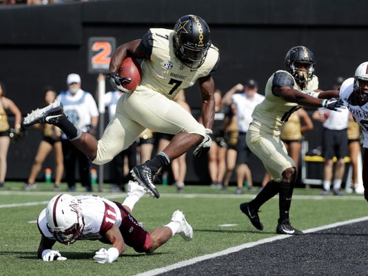 FILE - In this Saturday, Sept. 9, 2017, file photo, Vanderbilt running back Ralph Webb (7) jumps over Alabama A&M defensive back Harvey Harris (11) on his way to scoring a touchdown on a 6-yard run in the first half of an NCAA college football game in Nashville, Tenn. Vanderbilt is off to its best start in years at 3-0 with the latest win an upset of Kansas State. Coach Derek Mason says the key is experience, and he has that.Webb, Vanderbilt's all-time leading rusher, has 40 consecutive starts (AP Photo/Mark Humphrey, File0