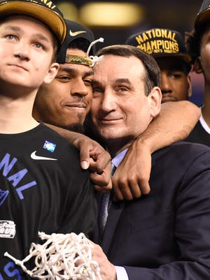 Duke Blue Devils guard Quinn Cook and head coach Mike Krzyzewski  embrace after defeating the Wisconsin Badgers 68-63 in the 2015 NCAA Men's Division I Championship game at Lucas Oil Stadium.
