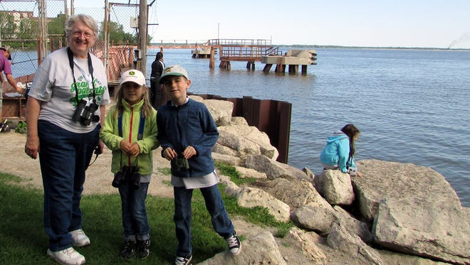 Columnist Susan Manzke stands at the mouth of the Fox River observing wildlife with her grandchildren Arianna, and Eli during UWGB's Grandparents University.