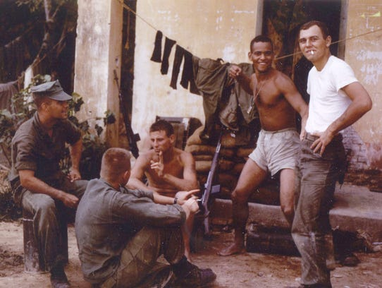 Tony Packowski, right, with other Marines during his