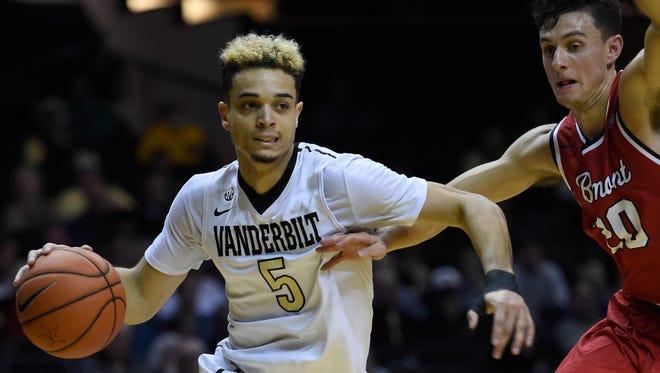 Vanderbilt guard Matthew Fisher-Davis (5) drives past Belmont guard Taylor Barnette (20) during the second half at Memorial Gym Tuesday, Nov. 15, 2016, in Nashville, Tenn.