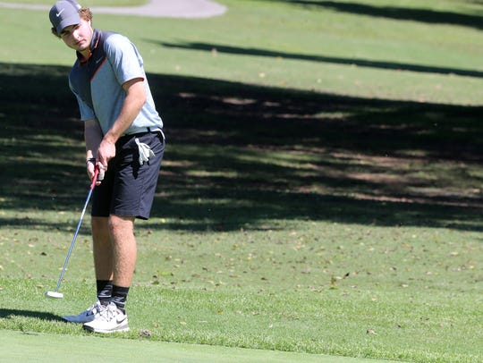 Blackman's Andrew Davis watches as his putt drops in