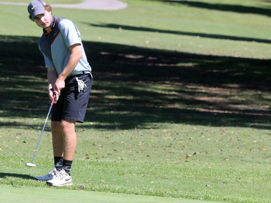 Blackman's Andrew Davis watches as his putt drops in on No. 16. Davis shot an 83 in the District 7-AAA golf tournament at Smyrna Municipal Golf Course.