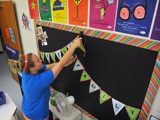 Cunningham Elementary teacher Amanda Beck decorates