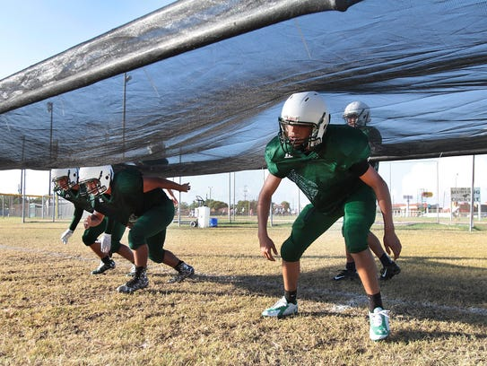 King football players work on a drill earlier this