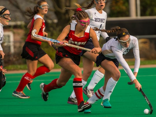 CVU #1 Lydia Maitland tries to squeeze out Essex #7 Hannah Palmer during their semi-final match up at UVM on Monday, Oct. 30, 2017. CVU pulled out the win, 2-1.