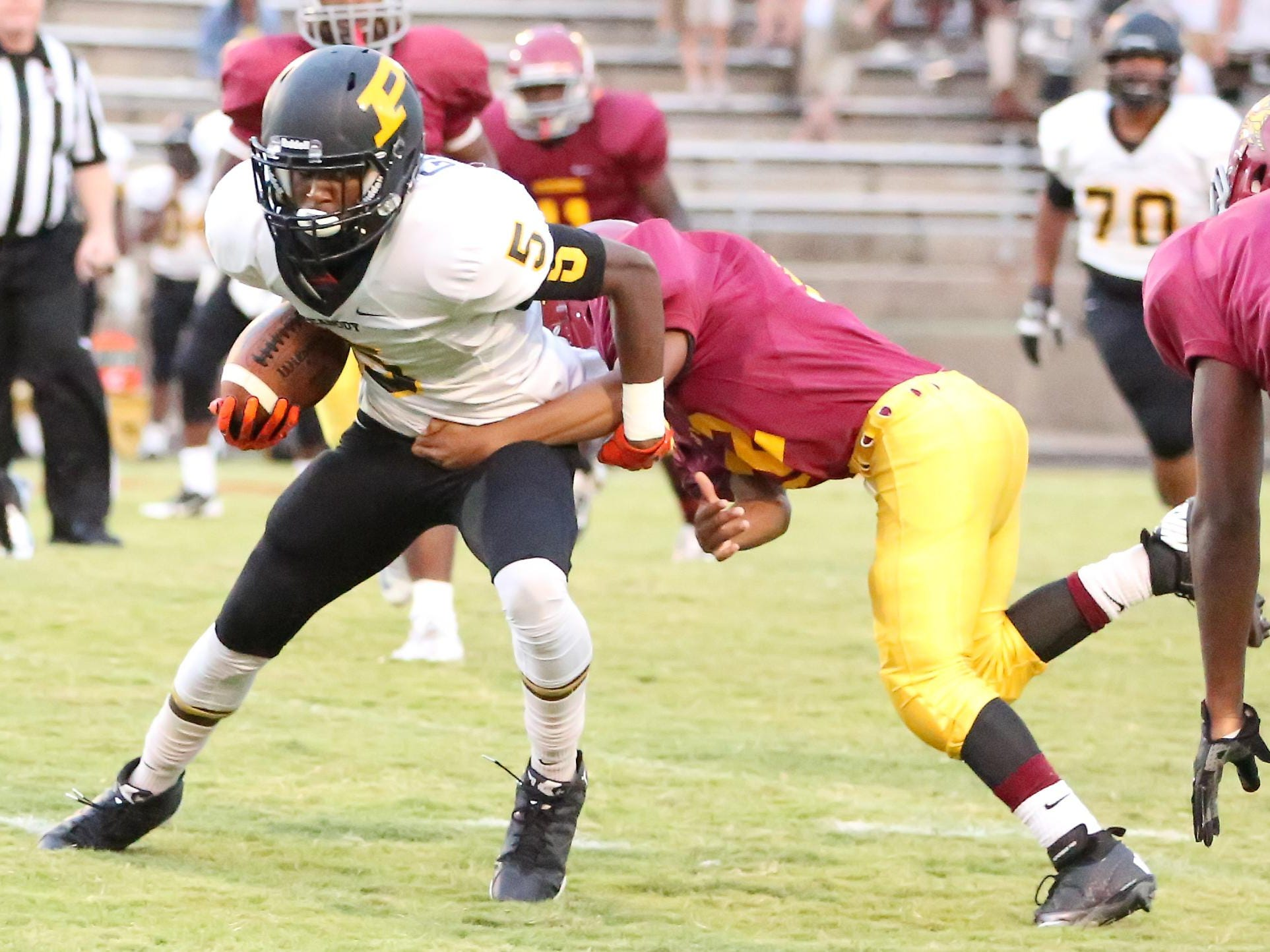 Trenton Peabody's Keyvon Goodwin gets tackled by Humboldt's Denzel Epperson on Friday night.