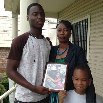 Niguel McCord, left, with Ferlusia Bell and brother