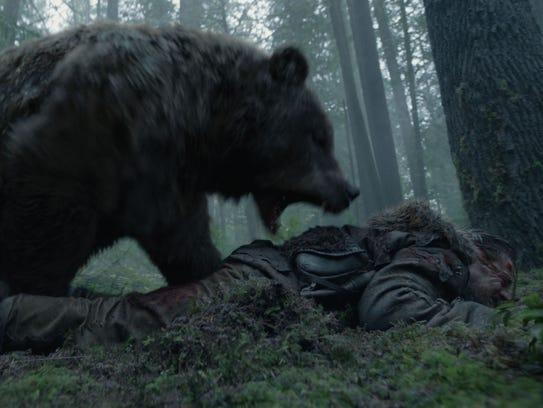 Hugh Glass (Leonardo DiCaprio) is brutally mauled by