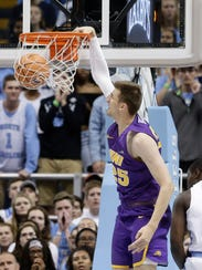 Northern Iowa's Bennett Koch dunks during the first half of an NCAA college basketball game against North Carolina in Chapel Hill, N.C., Friday, Nov. 10, 2017. (AP Photo/Gerry Broome)