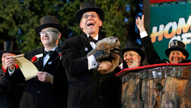 Groundhog Club handler Ron Ploucha holds Punxsutawney Phil during the 129th celebration of Groundhog Day on Gobbler's Knob in Punxsutawney, Pa., on  Feb. 2.