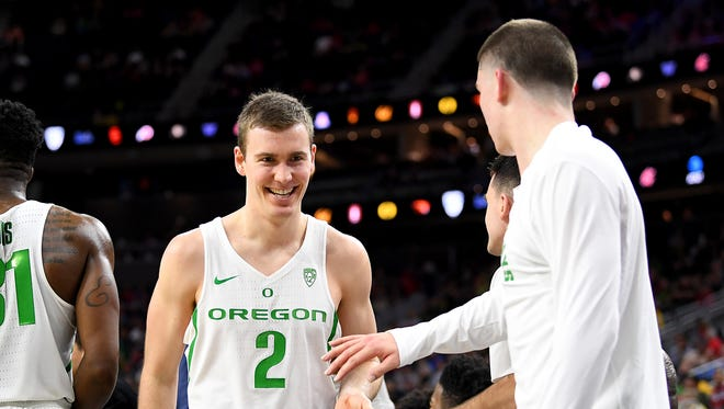 Mar 9, 2017; Las Vegas, NV, USA; Oregon Ducks guard Casey Benson (2) smiles as he returns to the bench near the end of a  Pac-12 Conference Tournament game against the Arizona State Sun Devils at T-Mobile Arena. Oregon won the game 80-57. Mandatory Credit: Stephen R. Sylvanie-USA TODAY Sports