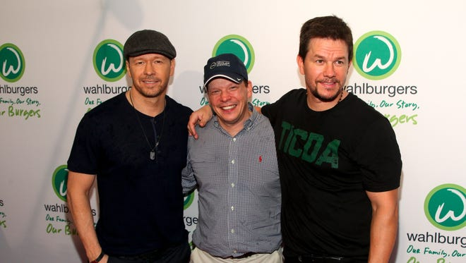 Donnie Wahlberg, from left, Paul Wahlberg and Mark Wahlberg attend the Wahlburgers Coney Island preview party in New York in 2015.