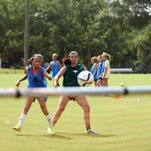 Mary Bradley, 10, and Emmy Fiala, 13, watch the ball fly towards the goal as they exercise their soccer techniques during the Bobcat Soccer Academy held at Jones County Junior College Tuesday morning.