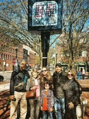 Christian Figueroa, second from right, poses for a photo at the shot clock monument in Syracuse that recognizes Elmira native Leo Ferris' contribution to creating the NBA's shot clock. Also pictured, from left, are Figueroa's dad, Nadir Figueroa; his aunt, Ann Thorner; his wife, Michelle Figueroa; his mom Joan Sponyoe Figueroa. In front is Christian's son, Christian Figueroa.