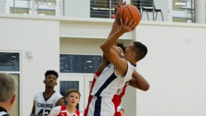 Ethan Shreffler, of Chambersburg, drives to the basket during pool play of the AYBA National Championship tournament. The Chambersburg 8th grade AAU team won the national AAU title after going 4-1 in the tournament.