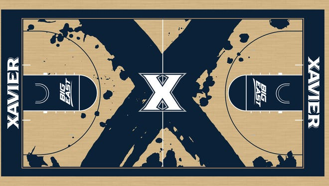 Xavier's auxiliary gym court will have this new look by the time exam week has ended.