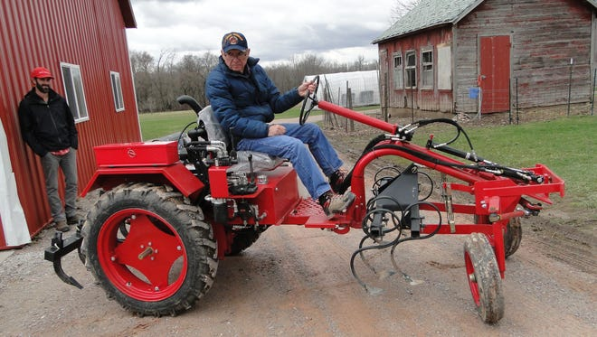 The Oggún  tractor doesn't have a logo because it does not belong to a company but to the farmer who uses it.  It is a basic tractor that can be repaired or modified using locally sourced parts and services. Here Horrace Clemmons describes how the tractor is different, including the zero-turn feature.