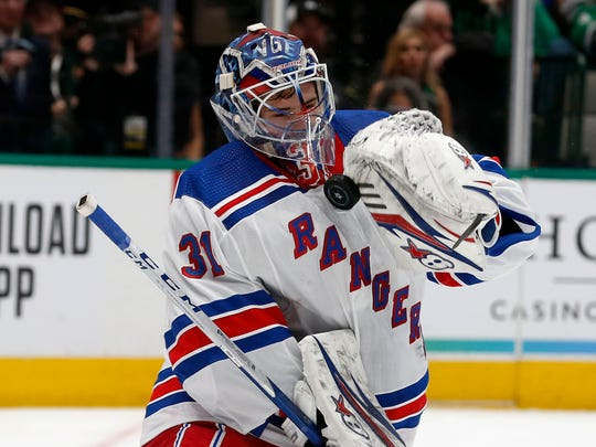 New York Rangers goaltender Igor Shesterkin deflects a shot by the Dallas Stars during the first period of an NHL hockey game in Dallas, Tuesday, March 10, 2020. (AP Photo/Michael Ainsworth)