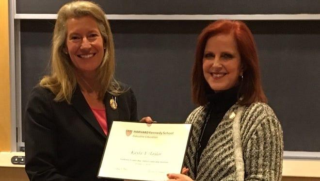 Jackson's Kayla Taylor receives her certification of attending the Harvard Kennedy School for leadership development.