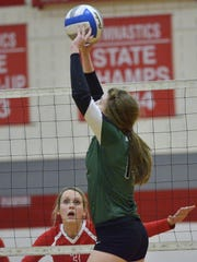 Novi's Erin O'Leary passes the ball while Canton's Hannah Madis waits for the play to develop.