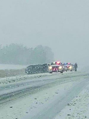 St. John driver Deane Ramirez slid off U.S. Highway 281 several miles north of Pratt on Wednesday morning because of snowy conditions. She was not injured in the accident. photo by Tonja Harrison