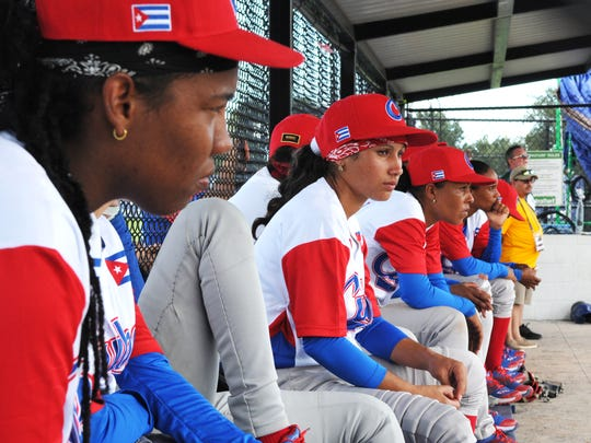 Members of the Cuban team in the dugout during the