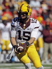 Minnesota quarterback Conor Rhoda prepares to hand off a ball in the second half Oct. 15 against Maryland in College Park, Md.