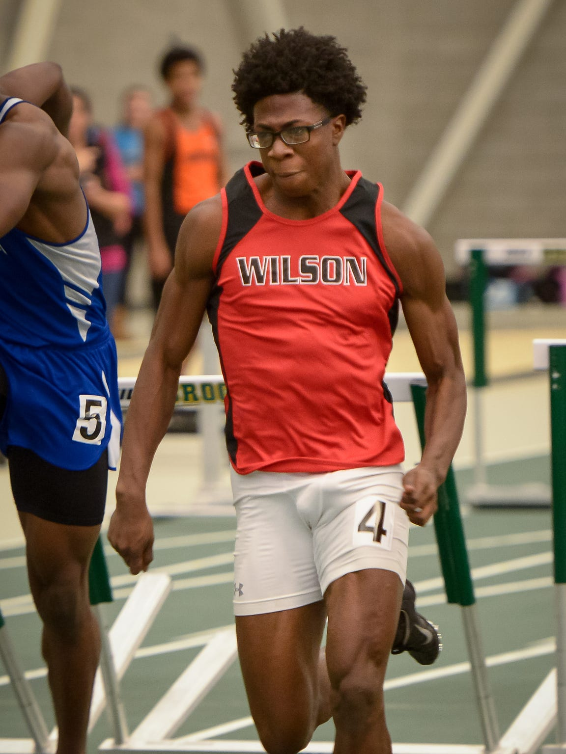 Kelly Brown of Wilson High School competes in his winning run of the 55 hurdles in 7.7 seconds.