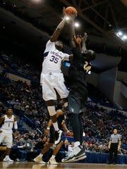 Tacko Fall on defense against Connecticut center Amida