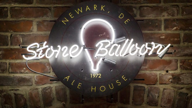 A neon Stone Balloon sign hangs in the interior of the new Stone Balloon Ale House in Newark.