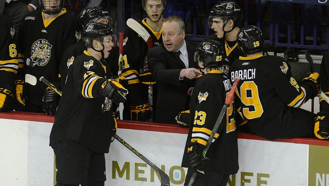 Green Bay Gamblers head coach Pat Mikesch talks with Christopher Brown (17) and Joey Marooney (23) during a USHL game against the Youngstown Phantoms at the Resch Center in Ashwaubenon. Brown was traded during the season, while Marooney is projected to return to next year's squad.