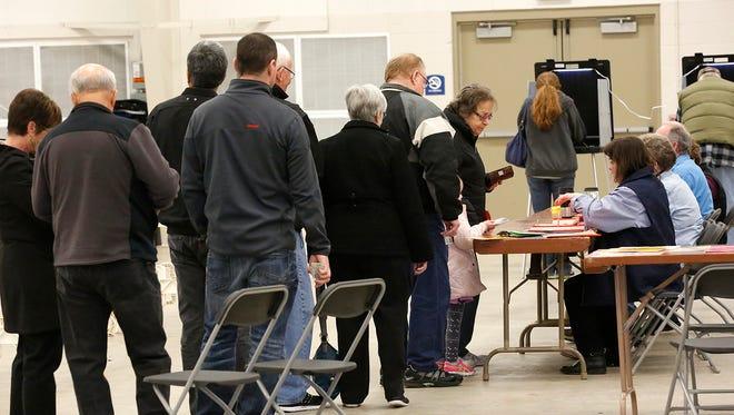 Fond du Lac community voters line up to vote.