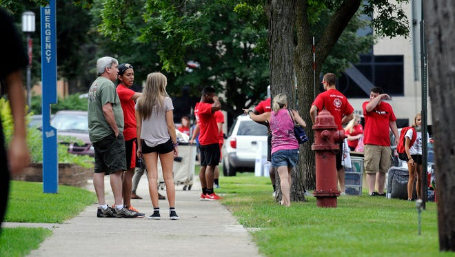 Student volunteers help new and returning St. Cloud State University students at Mitchell Hall during move-in day on Thursday morning, Aug. 18, 2016, in St. Cloud.