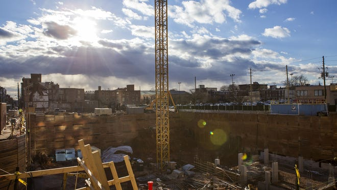 Construction continues on a new residential building at the site of a former parking garage at Shipley and Ninth Streets in Wilmington in December 2016.