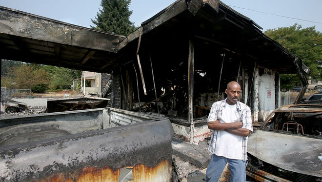 Danny Mills the manager of Motor City Automotive in Bremerton surveys the site of his auto shop lot on Monday. The shop was destroyed in a fire.