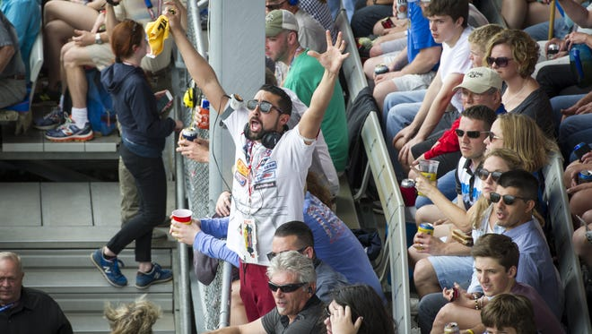 A fan reacts as he watches a pass on the track during the running of the 101st Indianapolis 500, at Indianapolis Motor Speedway, Sunday, May 28, 2017.